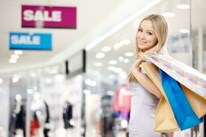 Attractive smiling blonde on shopping in shop